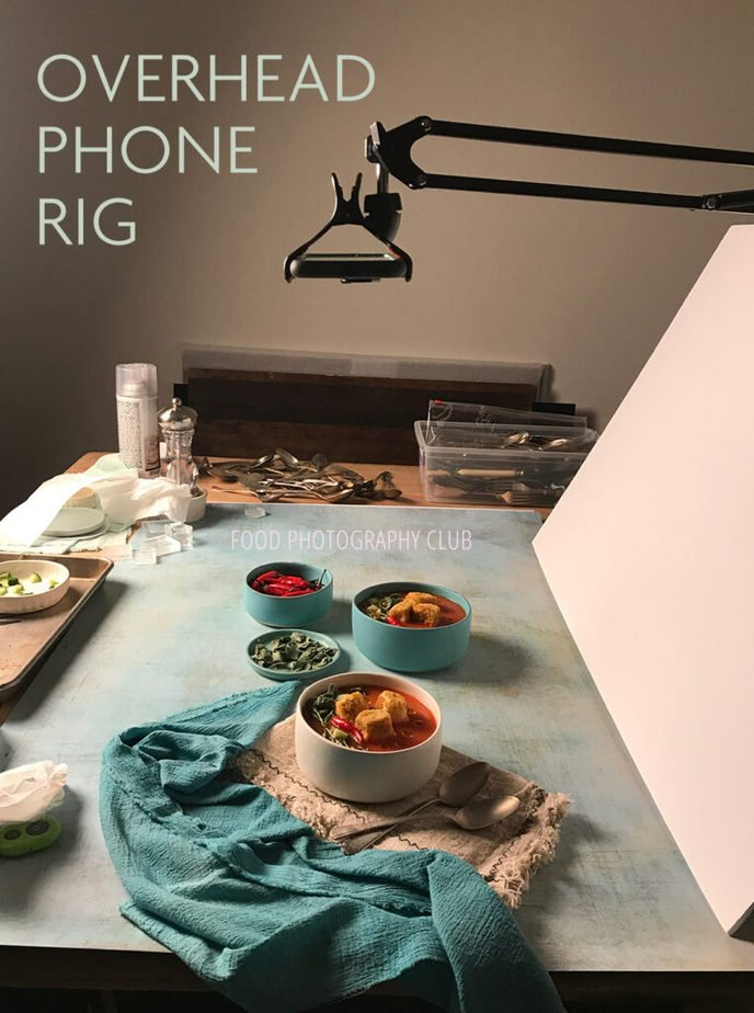 Image showing a phone in an overhead rig over a set of food
