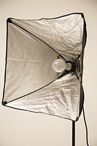Incandescent soft box with the diffusion panel removed so you can see the light bulb inside