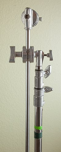 Image of a c-stand showing the top knuckle and the c-stand arm