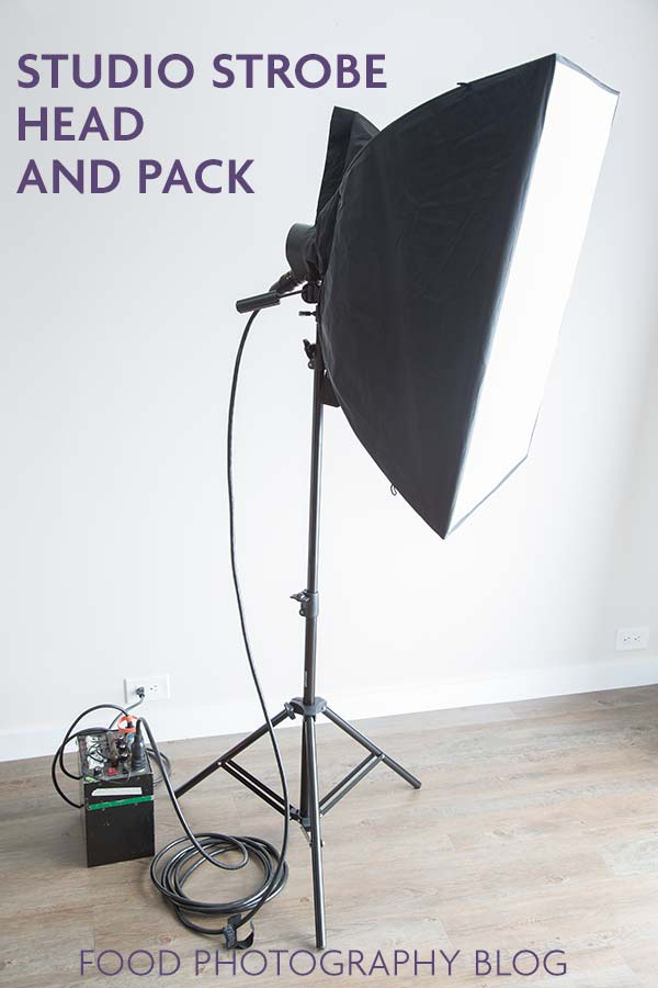 Image of a studio strobe head plugged into a strobe pack