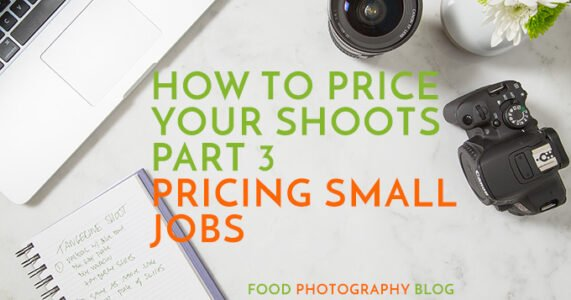 "Overhead image of a desk with computer and two lenses with the text, ""How To Price Your Shoots Part 3, Pricing Small Jobs"""