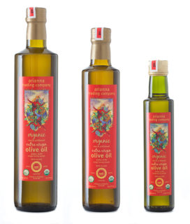 3 bottles of olive oil on a white background