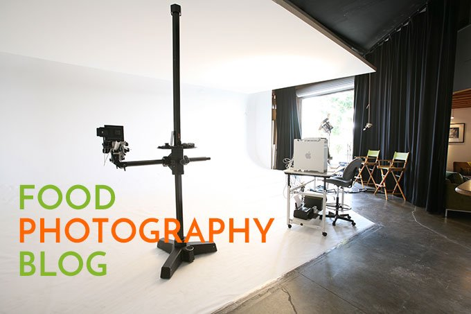 Photo of a photography studio with white walls and white floors with the text, Food Photography Blog