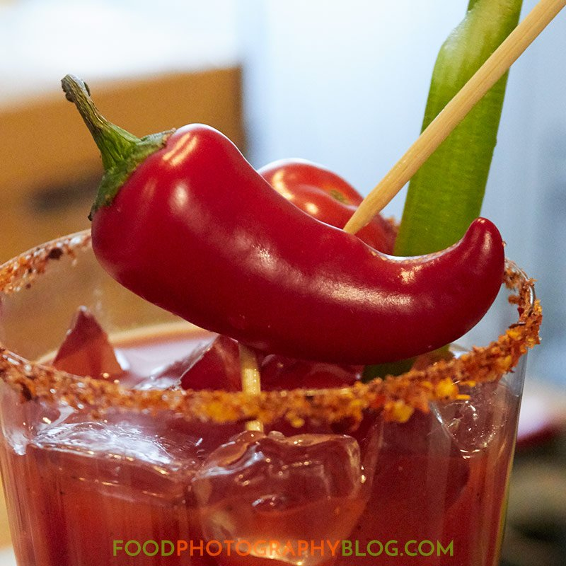 Close up of bloody mary garnish with wooden skewers