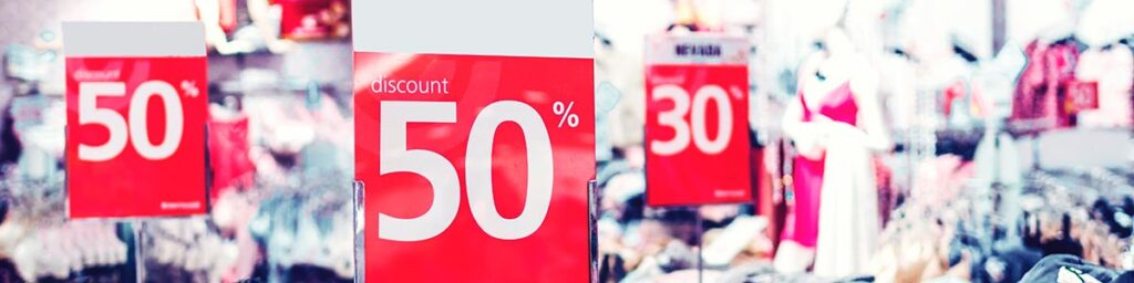Image of signs showing discount pricing
